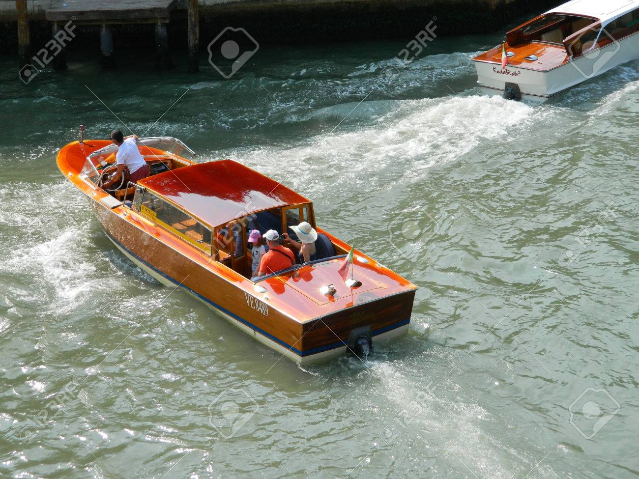VENICE, ITALY - 6 JULY 2015 Wooden Venice taxi motorboat with passengers water taxi in Grand Canal Stock Photo - 55334623