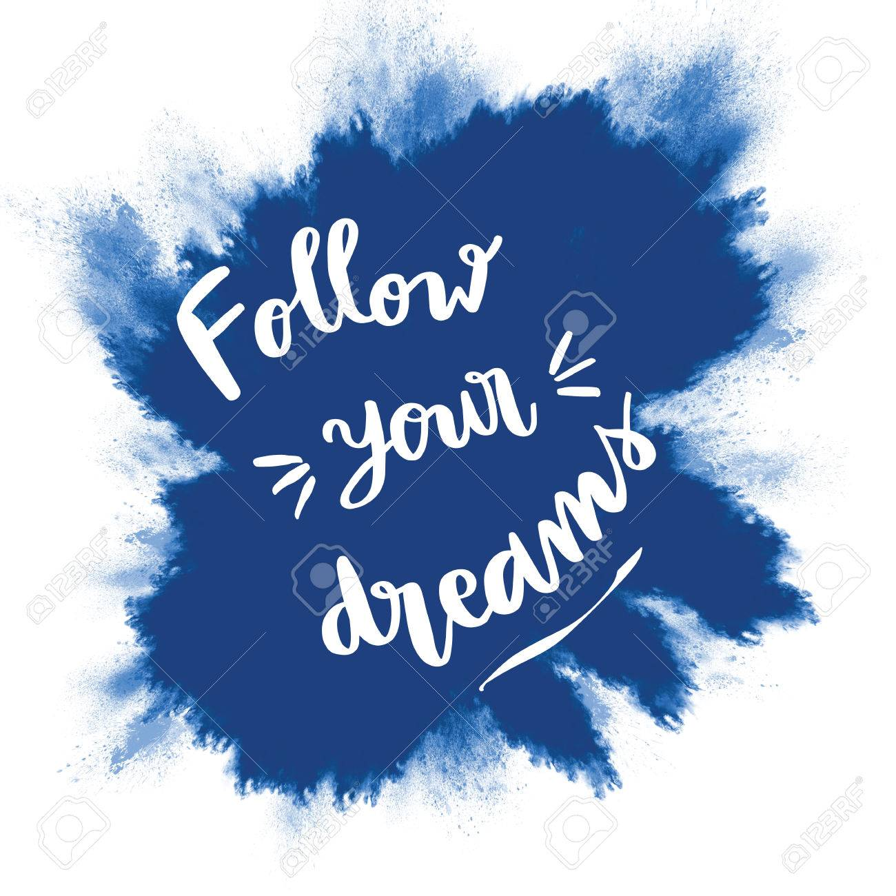 Follow Your Dreams Inspirational Message On Blue Splash Background Stock Photo
