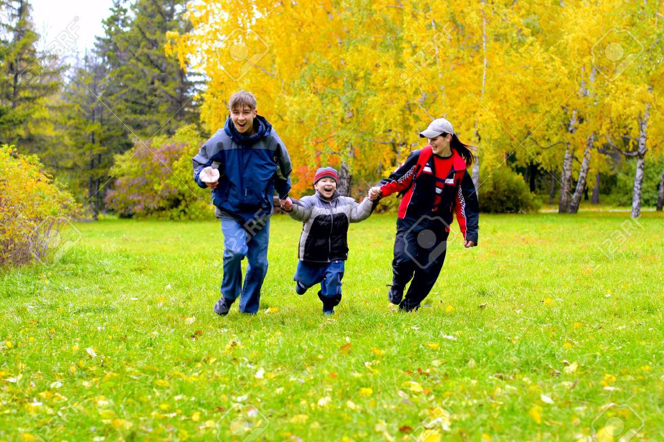 happy teenagers runing in the autumn park Stock Photo - 3746426