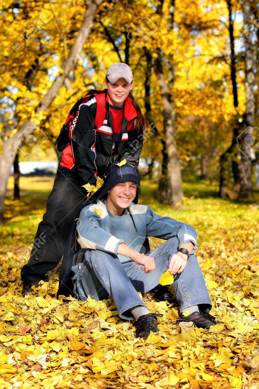 two happy teens in the autumn park Stock Photo - 3719393