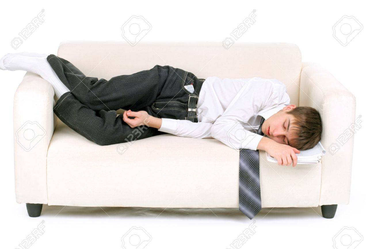 tired teenager sleeping on the sofa Stock Photo - 7184351
