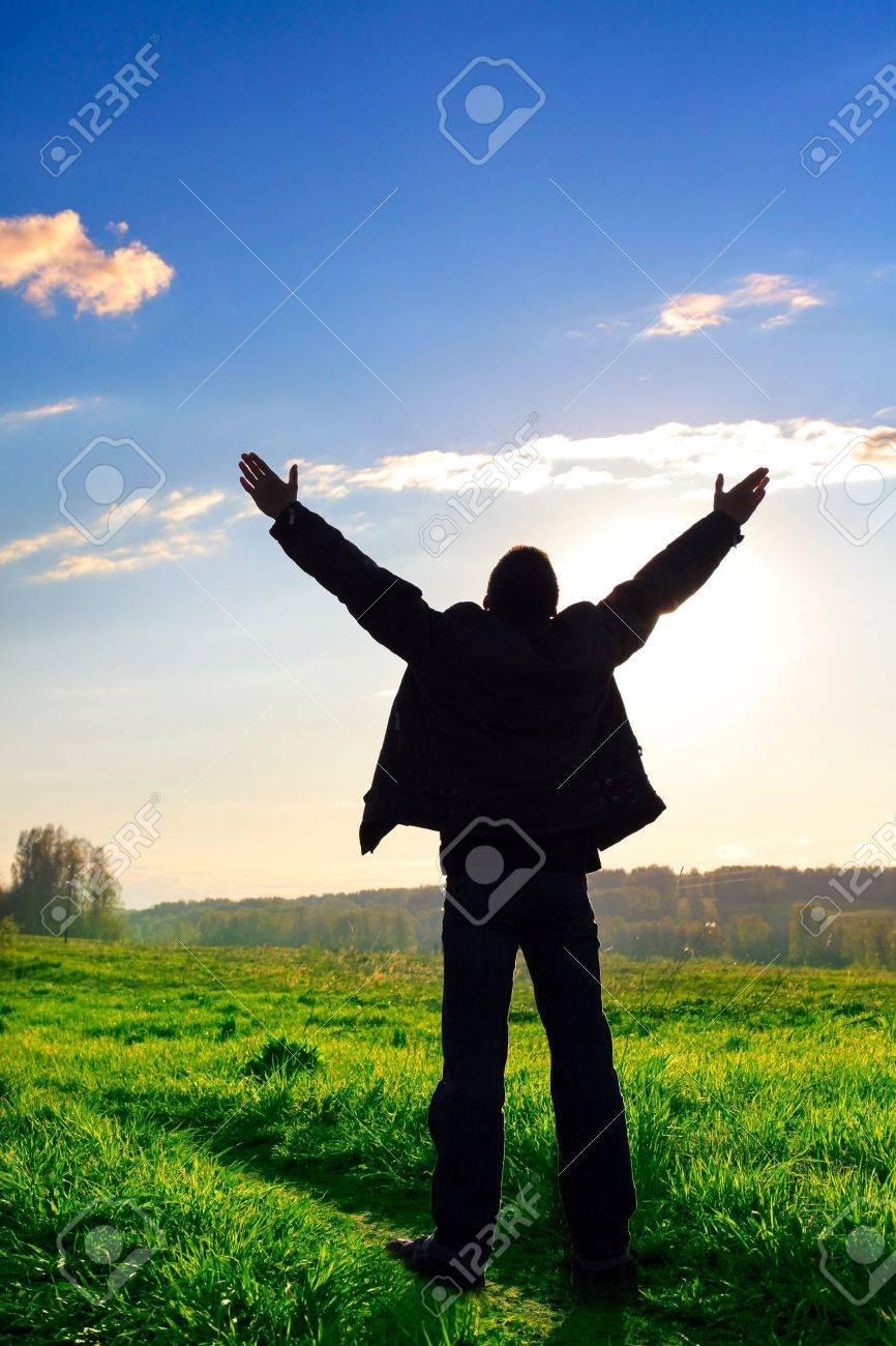 praying man silhouette on sunset background Stock Photo - 10355123