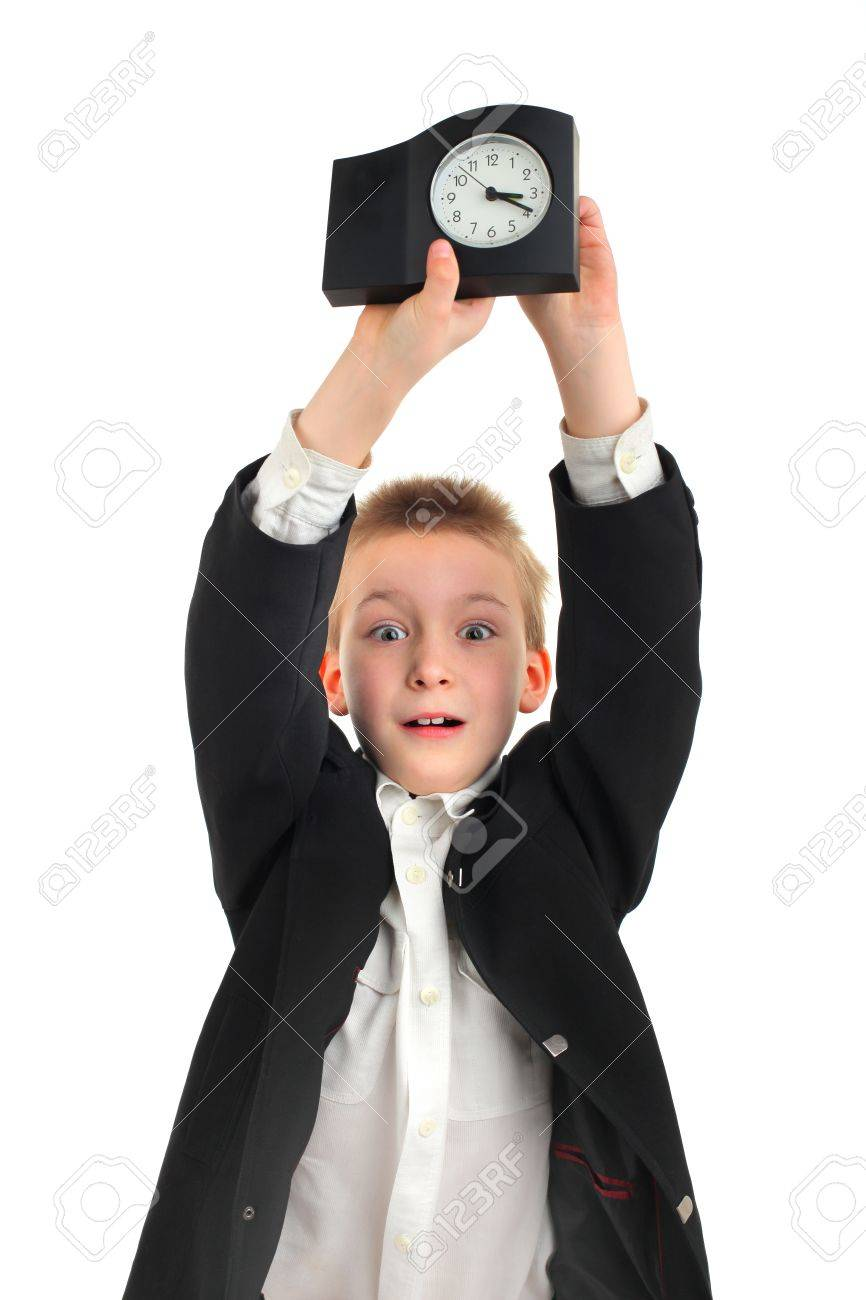 surprised schoolboy with a clock on the white background Stock Photo - 12183697