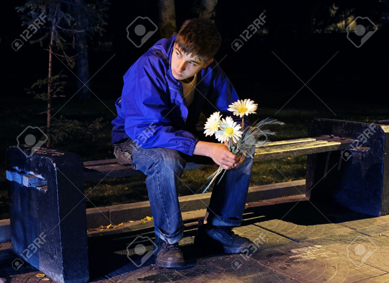 Sad Teenager In The Night Park With Flowers Stock Photo Picture And