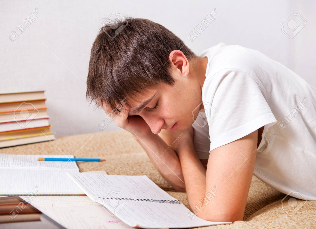 Tired Student Doing Homework On The Sofa Stock Photo, Picture And ...