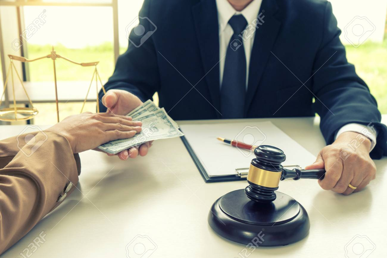 Judge Lawyer Gavel With Bribe Money In Law Firm Concept Corruption Stock  Photo, Picture And Royalty Free Image. Image 92359730.