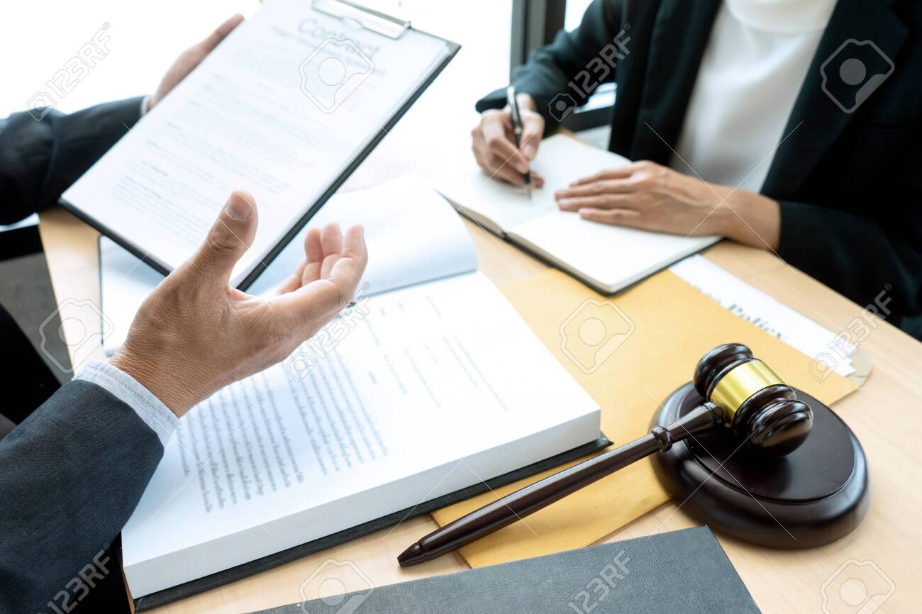 Lawyer or judge gavel with balance work with client or customer about agreement how to use arbitration - 128554607