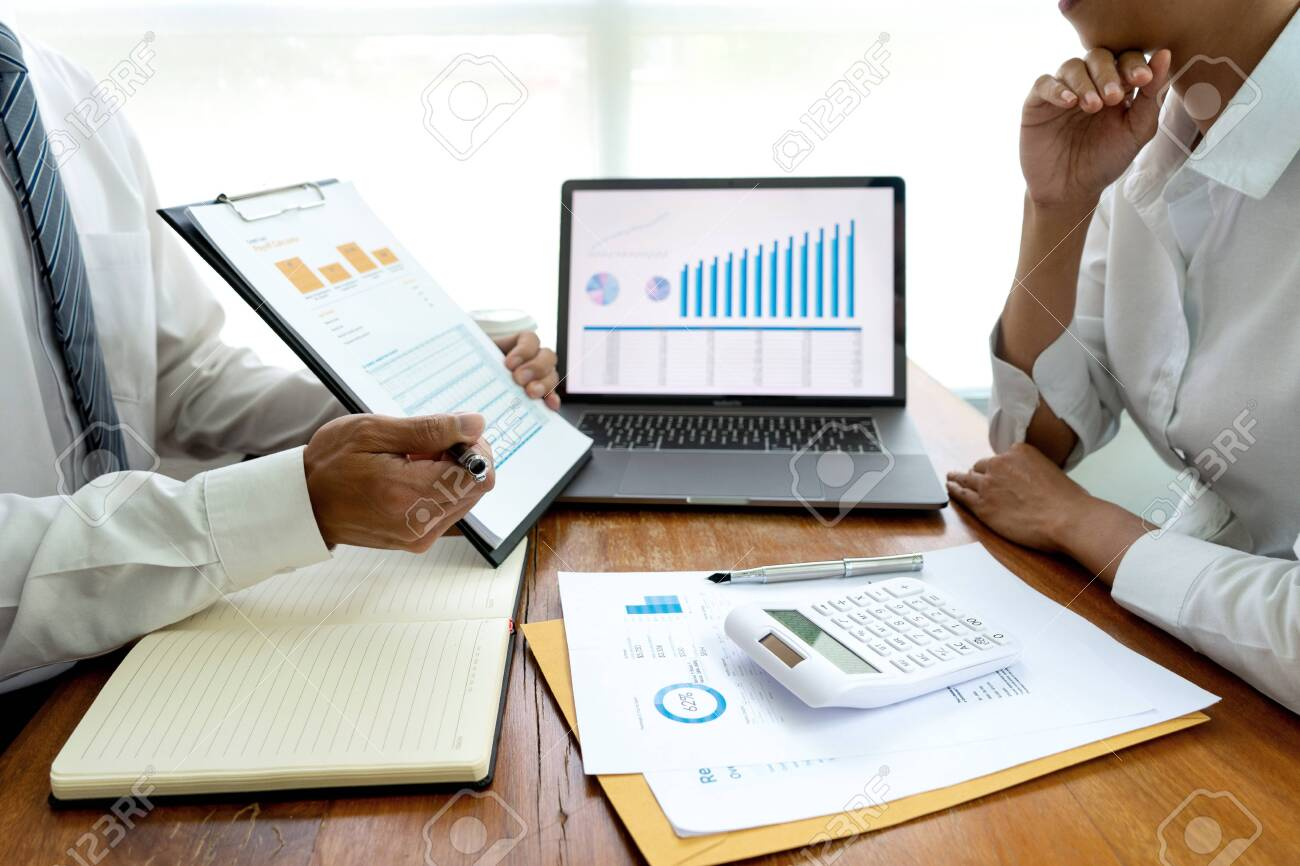 business team in casual style have small meeting in the office talk about analyses chart graph marketing plan with computer laptop calculator. - 144416581