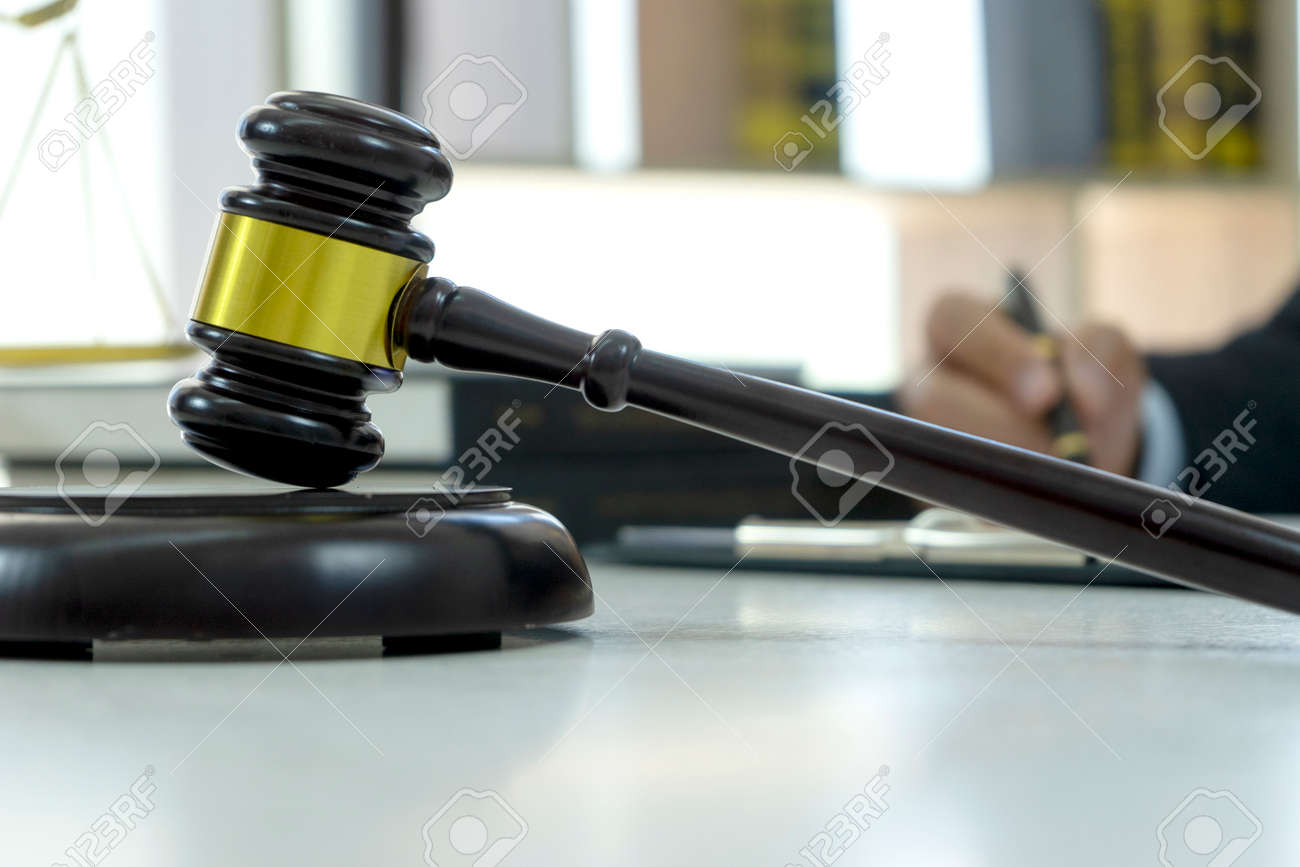 Closeup of wood gavel on the table it is the symbol of law justice on the legal - 169229311