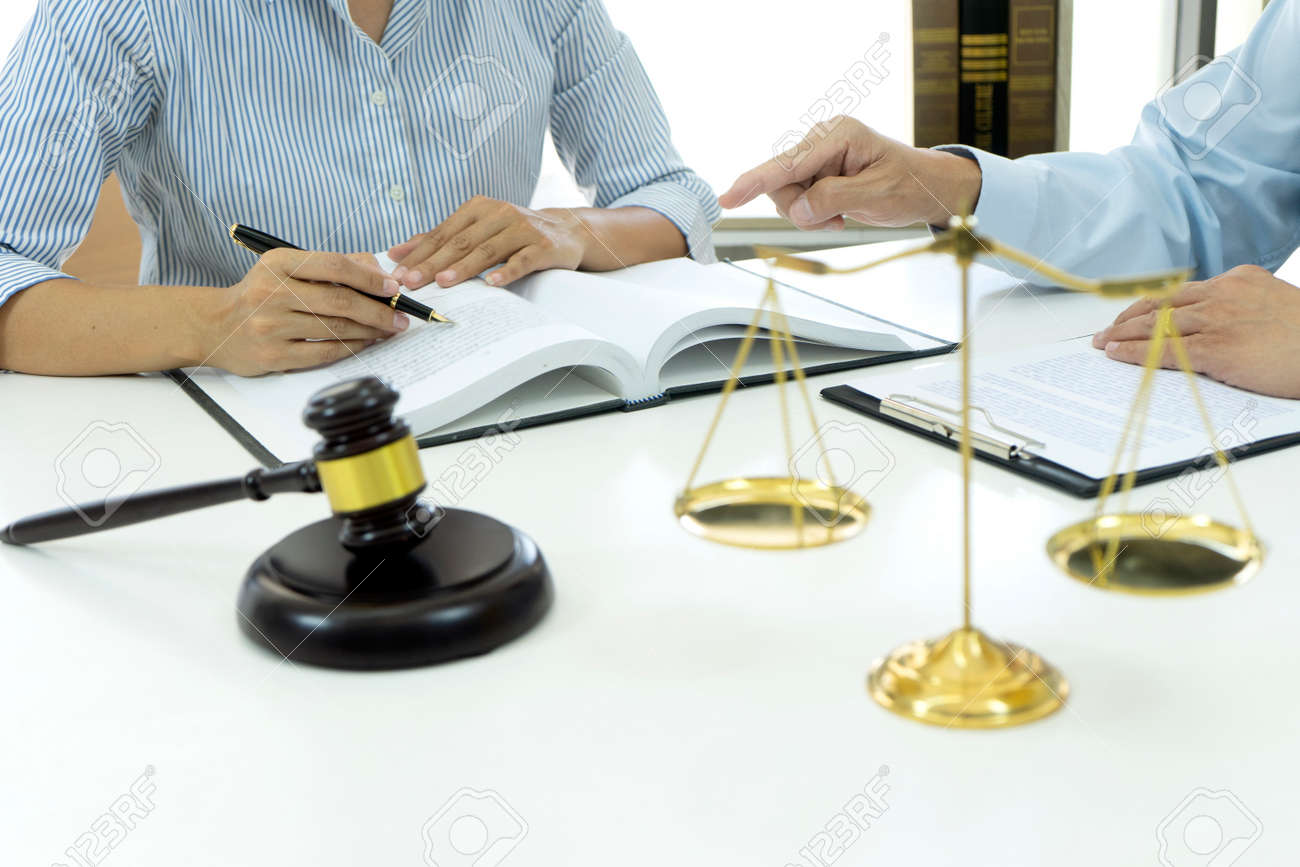 Lawyers and assistants are discussing legal matters to prepare business contracts and client solutions gavel and balance in the law firm - 169229750
