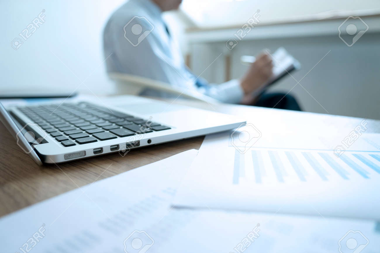 Smart businessman sitting thinking on a chair in the office his hand hold the pen with more copy space. - 169229937