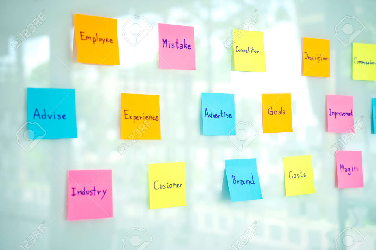 Lots of sticky note paper get stuck on the glass for group of staff to find the ideal in business planning. - 169232003