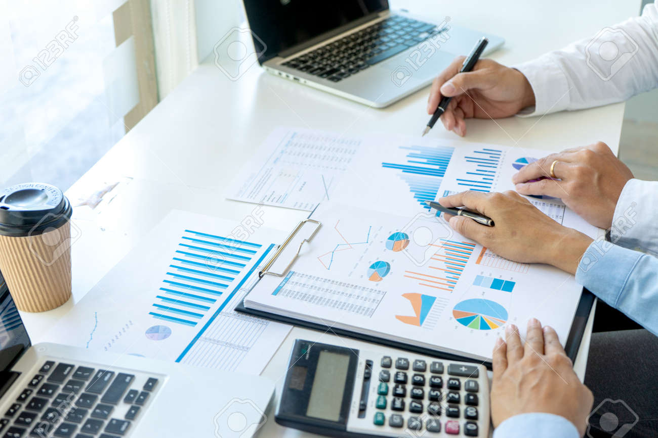 Businessman pointing at graphs paper of business in a graph analysis in office Marketing chart for marketing planning to generate sales - 169232048