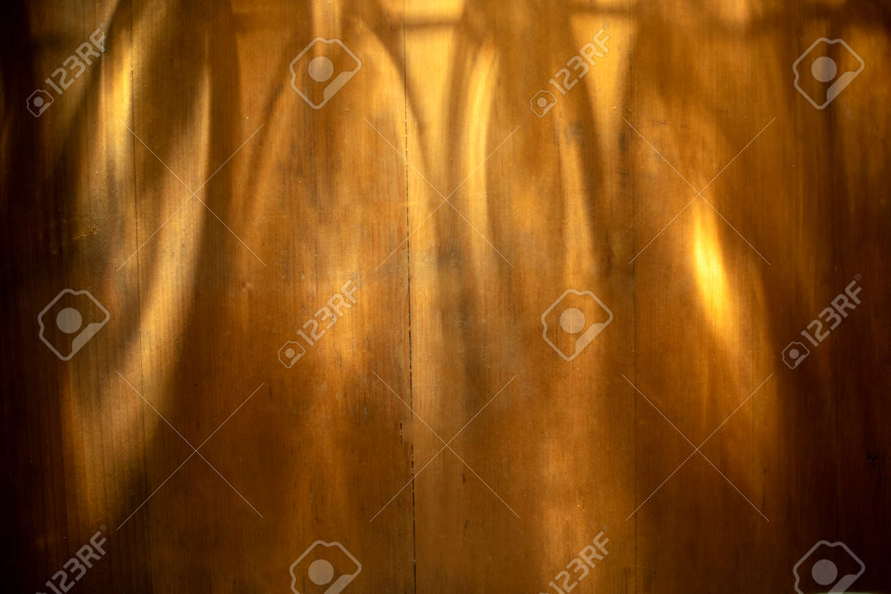 Light beam with Shadow on brown wooden background Texture Background Suitable for Product Presentation Backdrop Display and Mockup. - 169229429