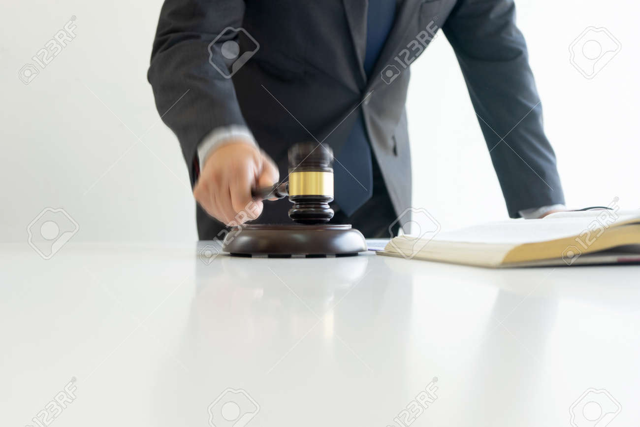 In the office of Judge or lawyer, there are balance and gavel on the table. Law firm Concept. - 169229441