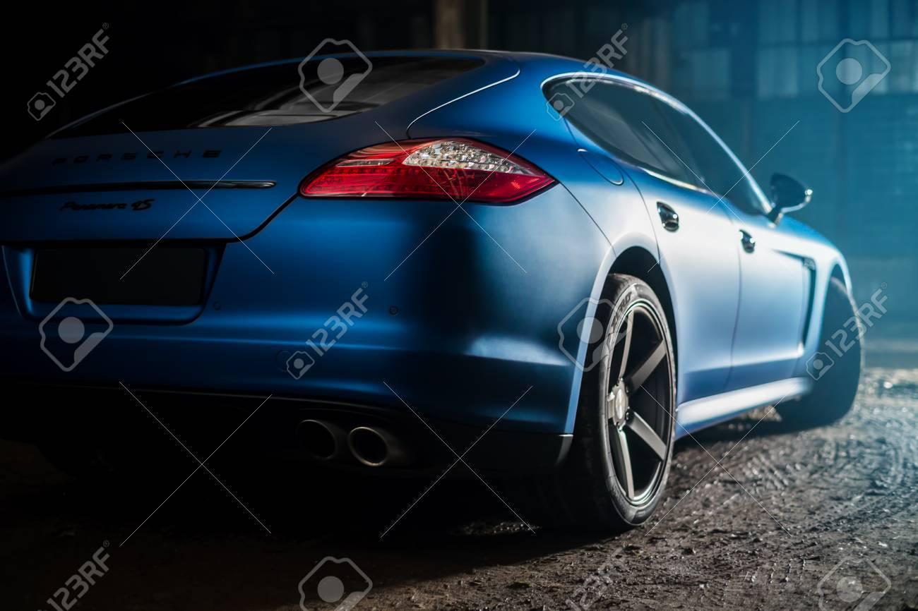 Kiev, Ukraine - 14 may 2014: Porsche Panamera blue in old factory. porsche panamera back view. - 74847765
