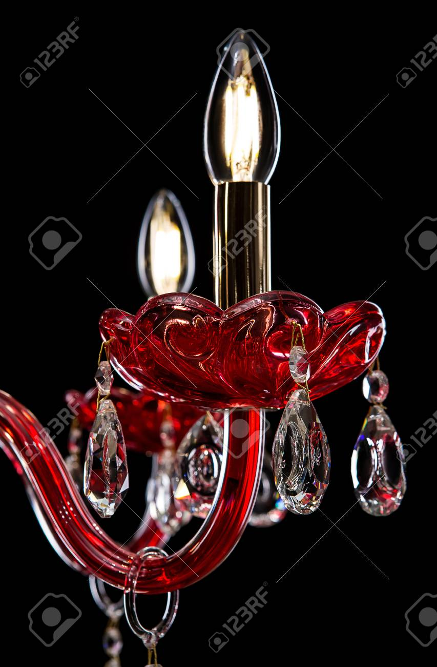 Contemporary red glass crystal chandelier isolated on black contemporary red glass crystal chandelier isolated on black background close up chandelier stock aloadofball Images