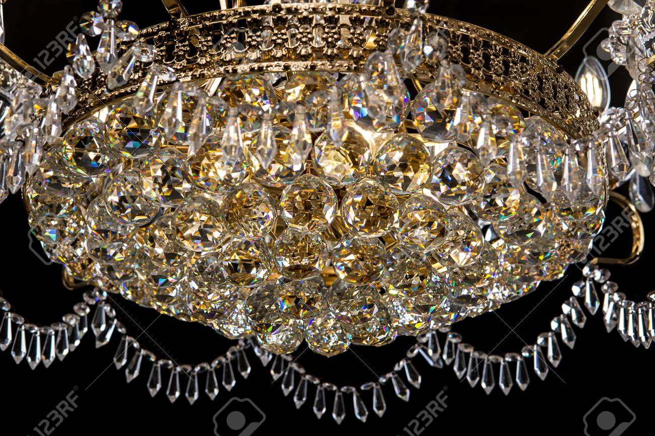 Contemporary Gold Chandelier Isolated On Black Background Close Up Crystal Stock Photo