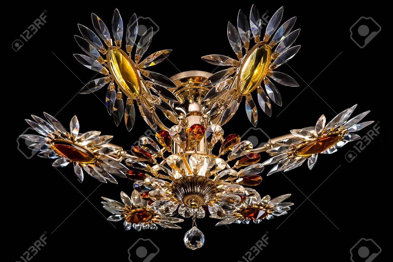 Contemporary gold chandelier isolated on black background crystal contemporary gold chandelier isolated on black background crystal chandelier decorated amber crystals close up aloadofball Gallery