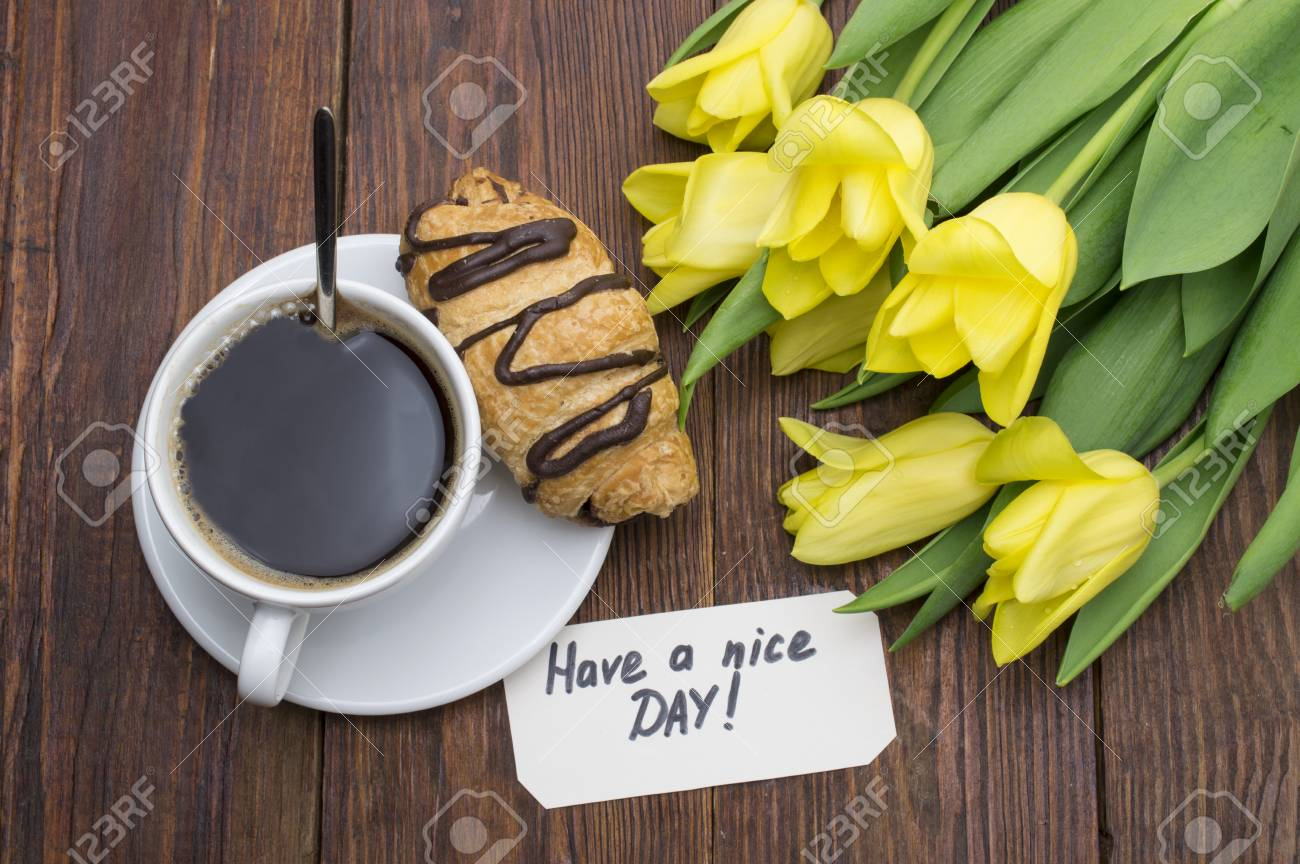 Cup of coffee, tulips and Good morning message