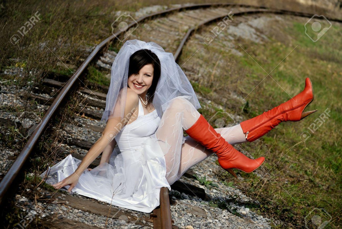 Runaway Bride. woman in a wedding dress Stock Photo - 8271788