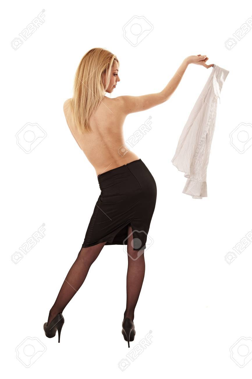 attractive girl holding shirt in hand. studio shot Stock Photo - 9567795