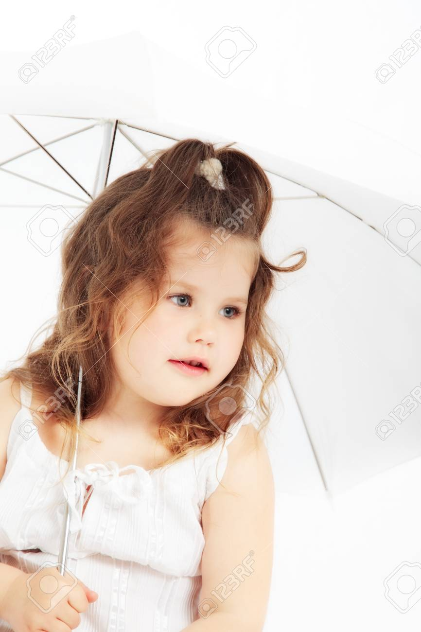 portrait of attractive young girl in white dress with umbrella Stock Photo - 11839653