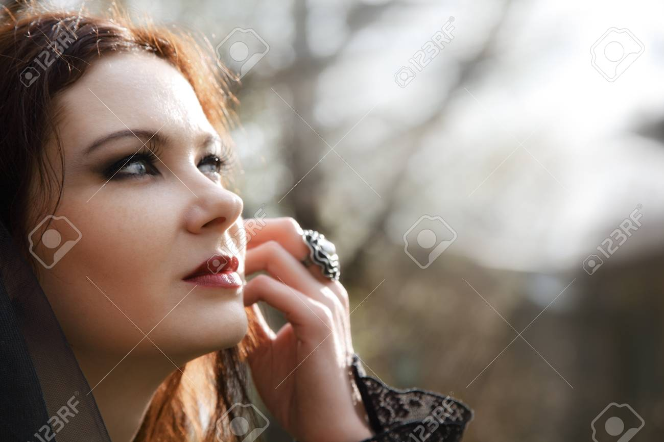 young woman in old style black dress and veil Stock Photo - 15036301