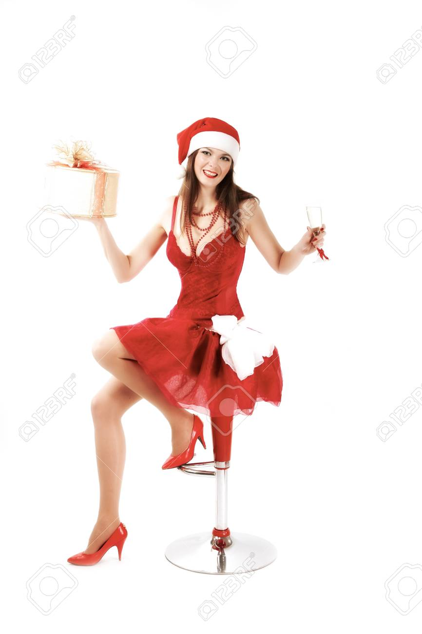 attractive woman in Xmas costume offers gift. studio shot Stock Photo - 15930259