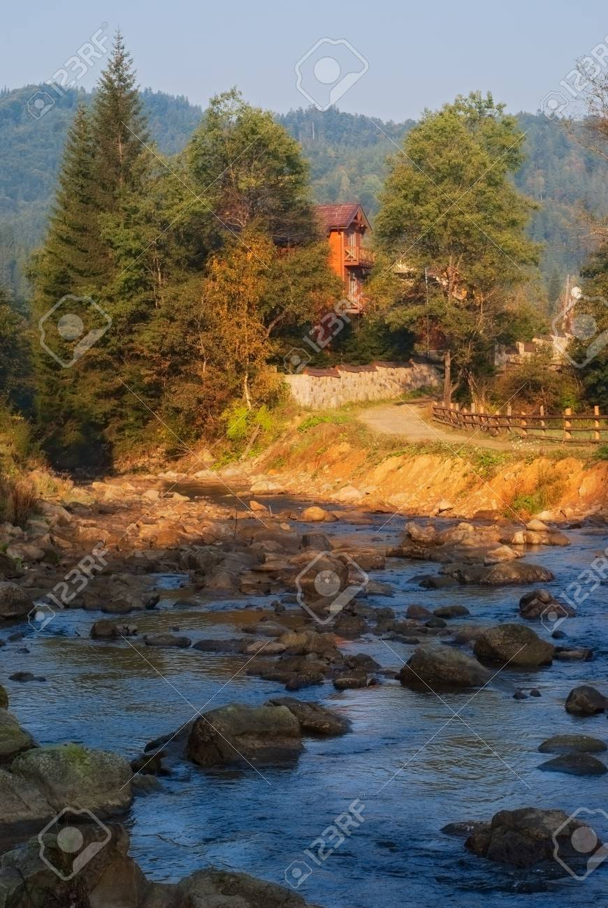 house in forest near rapid river Stock Photo - 16815001
