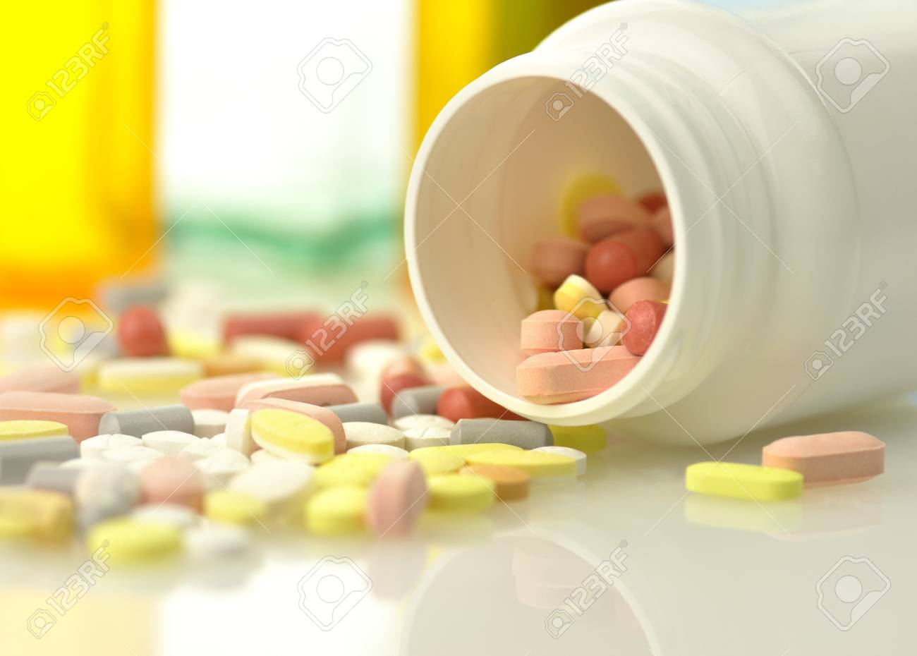 Medicine bottles and pills close up Stock Photo - 8645247