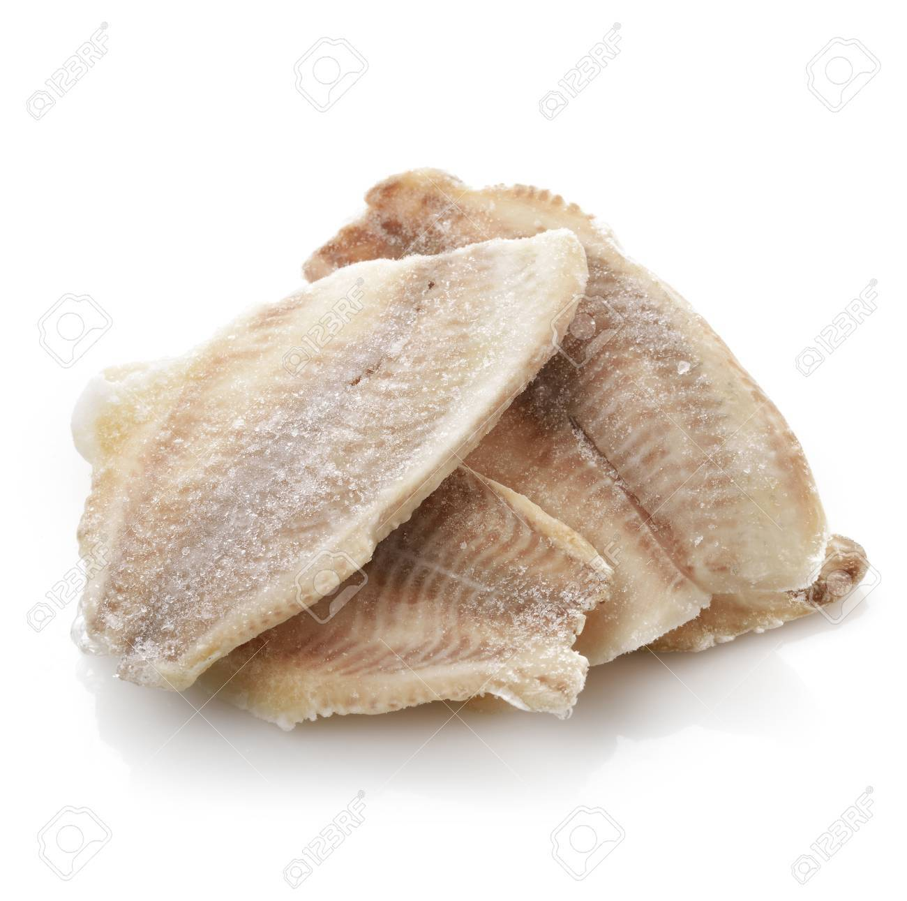 Frozen Tilapia Fillet On White Background Stock Photo Picture And Royalty Free Image Image 19329108