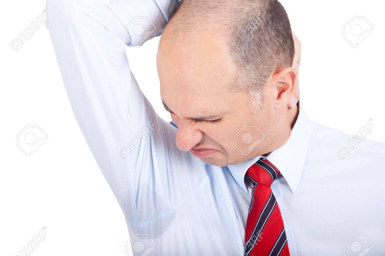 Business man notices a wet armpit Stock Photo - 13382424