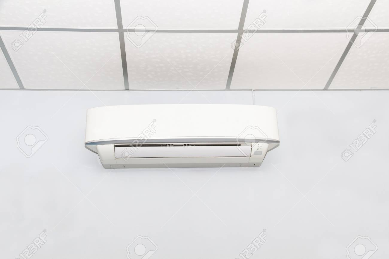 air conditioner on wall backgroundin white room conditioning stock