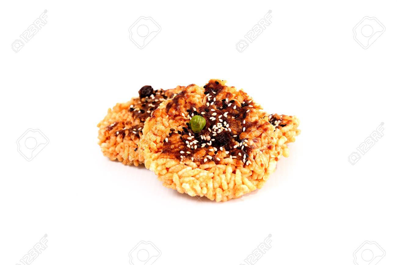 The rice is topped with sugar and the seeds are placed on a white background. - 87709119
