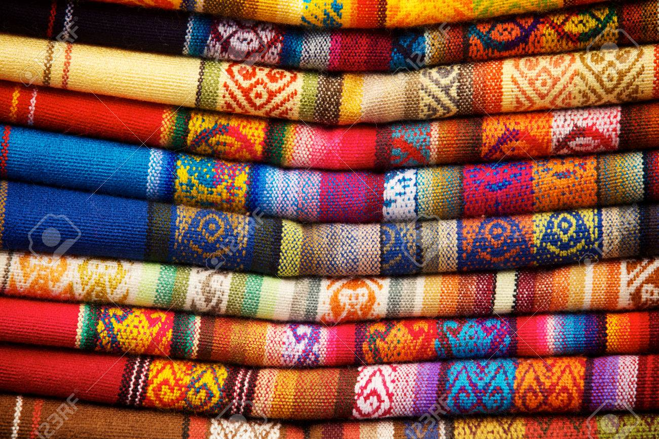 colorful blankets for sale in the market in otavalo ecuador stock  - colorful blankets for sale in the market in otavalo ecuador stock photo