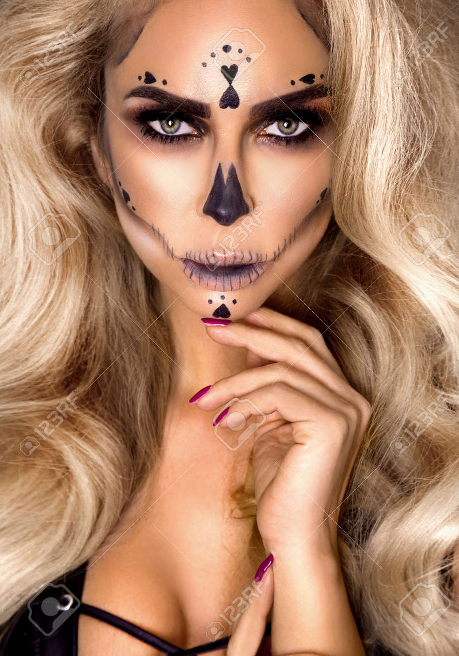 Halloween Sexy Witch portrait. Beautiful young woman in witches makeup with long curly blonde hair. Halloween makeup, visage. Wide Halloween party art design - Image - 167186271