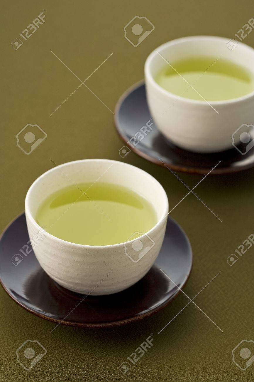 Green tea in a white cup on a dark background Stock Photo - 10323385