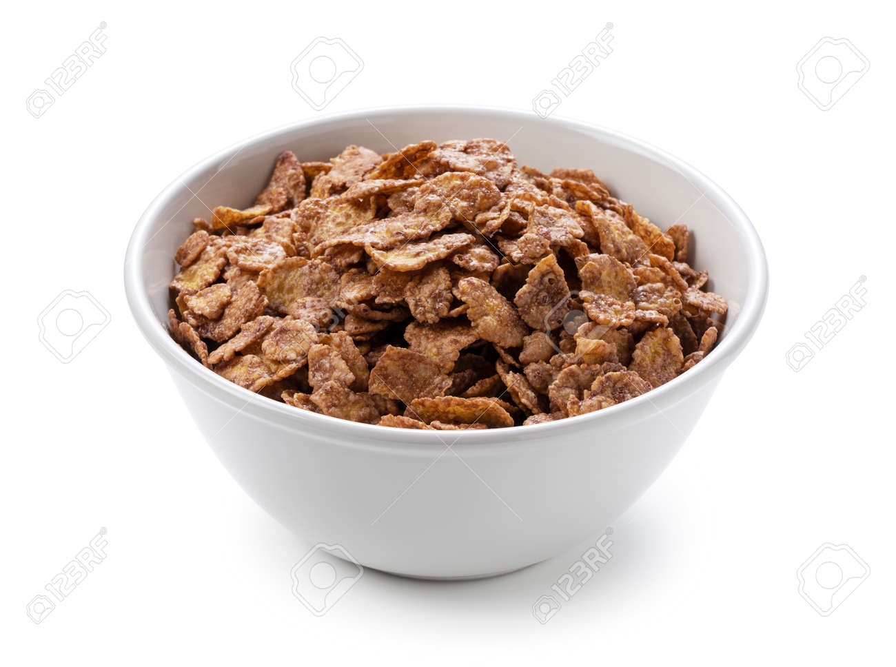Chocolate cornflakes in a white ceramic bowl set against a white background. - 169892576