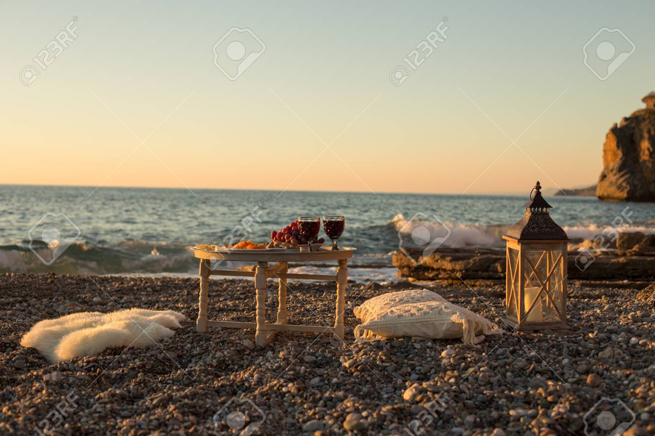 Romantic Outdoor Dinner With Wine And Cheese By Seaside. Two Glasses Of  Wine, Grapes