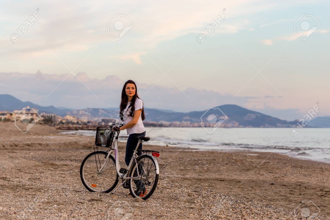 3fbd02246b64 Healthy Lifestyle By The Sea. Fit Girl With Long Dark Hair In ...