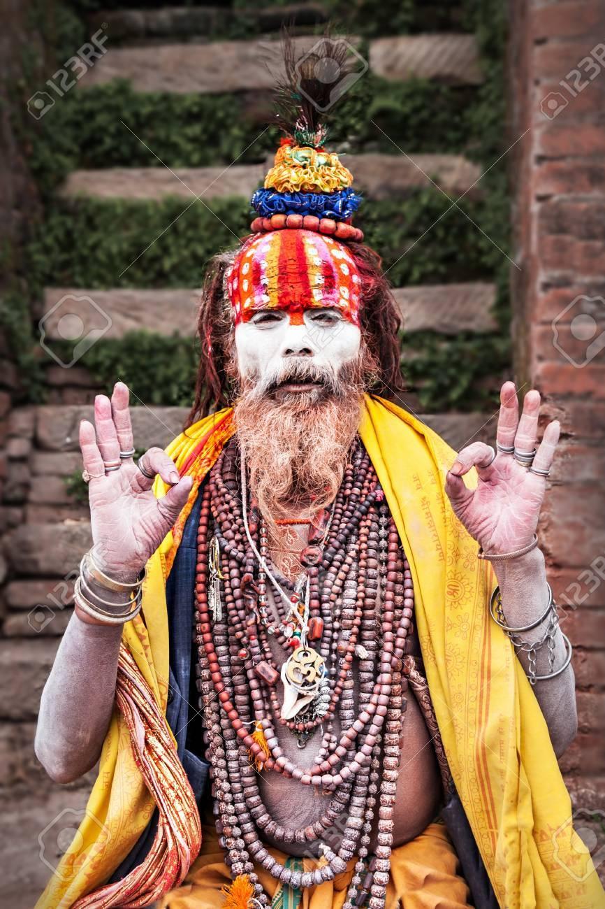KATHMANDU - APRIL 15: Sadhu at Pashupatinath Temple in Kathmandu, Nepal on April 15, 2012. Sadhus are holy men who have chosen to live an ascetic life and focus on the spiritual practice of Hinduism Stock Photo - 22053481