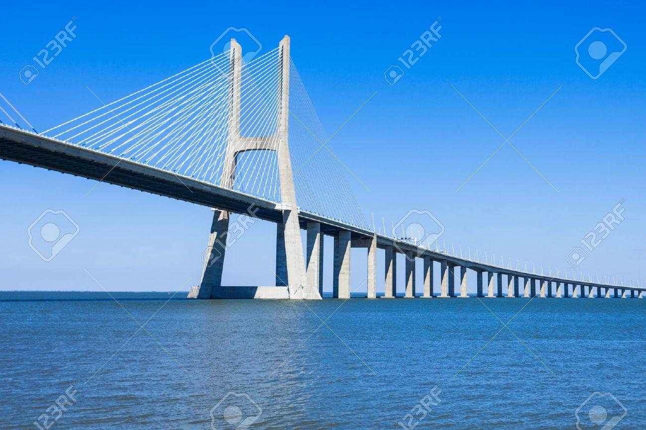 The Vasco da Gama Bridge in Lisbon, Portugal. It is the longest bridge in Europe - 53863018