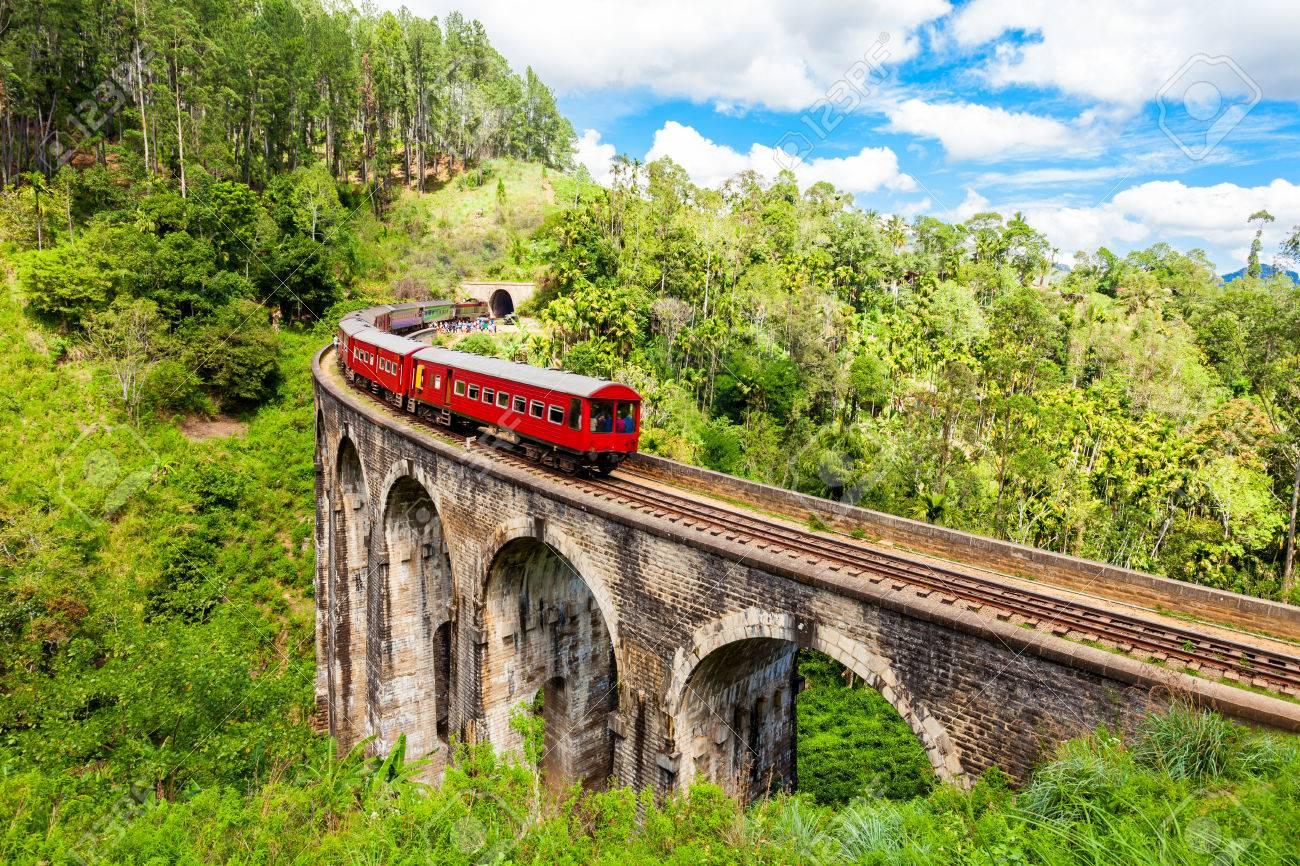 Train on the Nine Arches Demodara Bridge or the Bridge in the sky. Nine Arches Bridge is located in Demodara near Ella city, Sri Lanka. - 80611122