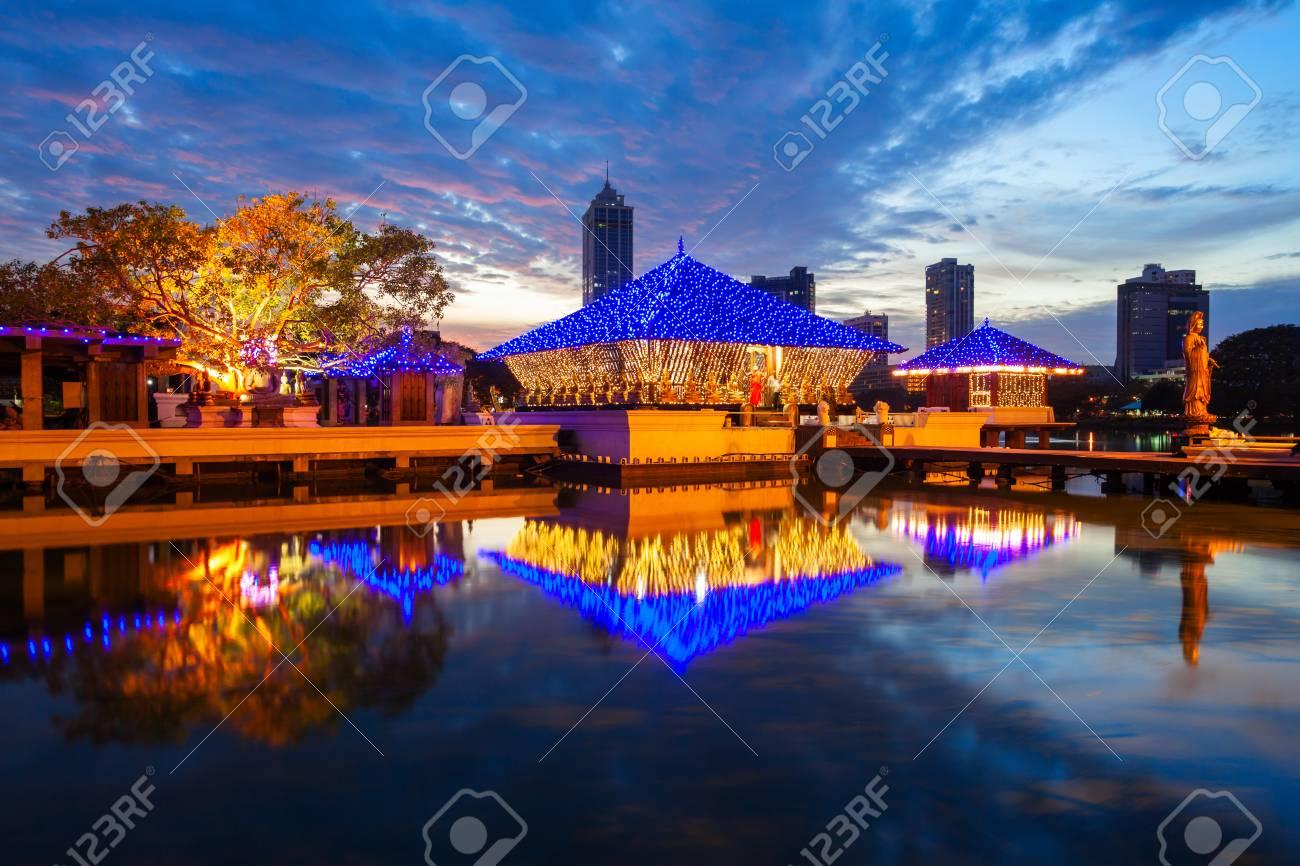 Seema Malaka buddhist temple in the Beira Lake in Colombo, Sri Lanka at sunset. Seema Malaka is a part of the Gangaramaya Temple. - 87733957