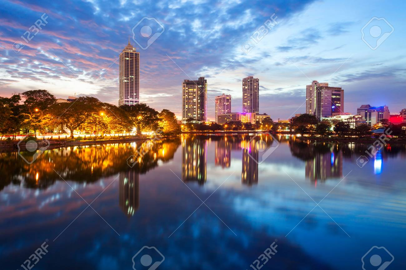 Beira lake and Colombo city skyline view at sunset. Beira lake is a lake in the center of the Colombo in Sri Lanka. - 87750938