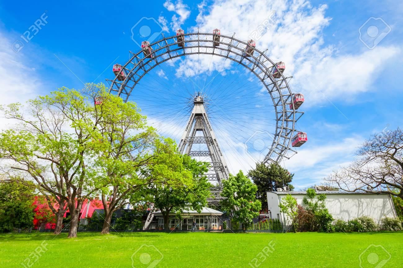 The Wiener Riesenrad or Vienna Giant Wheel 65m tall Ferris wheel in Prater park in Austria, Vienna. Wiener Riesenrad Prater is Vienna's most popular attractions. - 92556412
