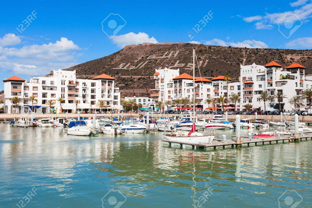 Boats at the Marina harbour in Agadir. Agadir is a major city in Morocco located on the shore of the Atlantic Ocean, near the Atlas Mountains. - 92686376