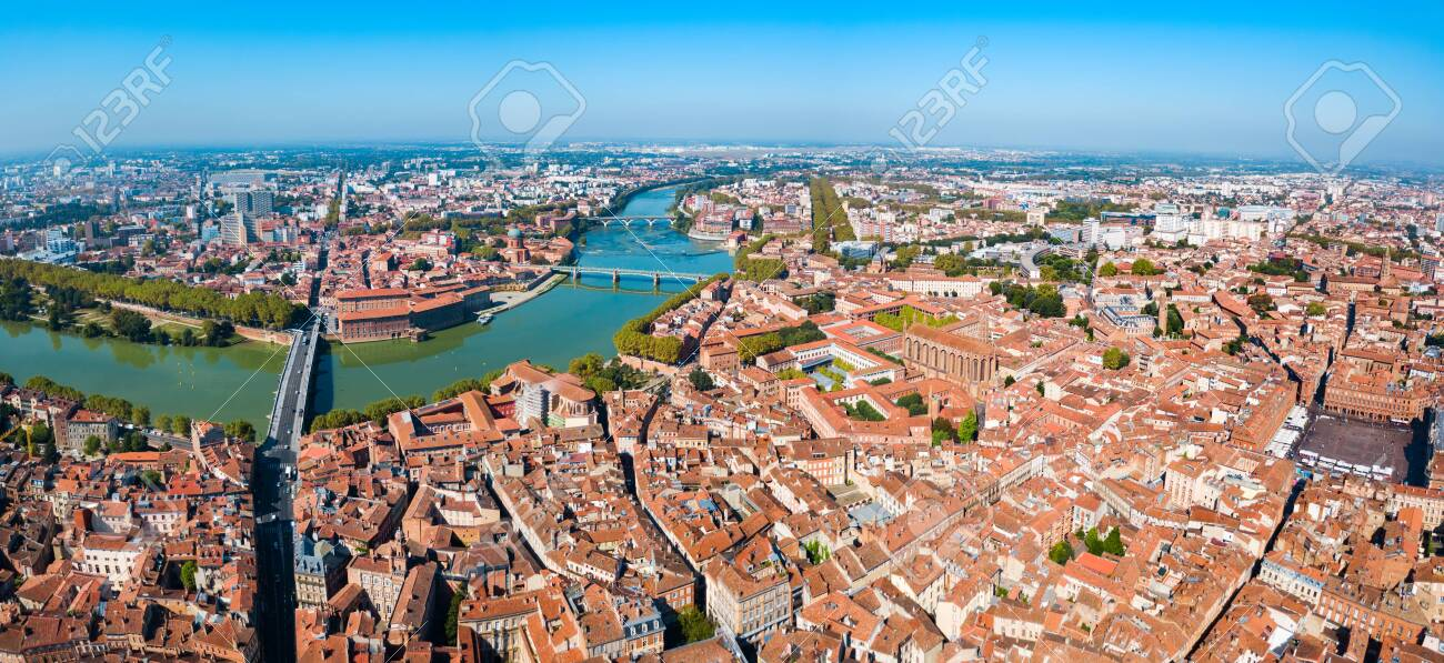 Toulouse and Garonne river aerial panoramic view. Toulouse is the capital of Haute Garonne department and Occitanie region in France. - 122423704