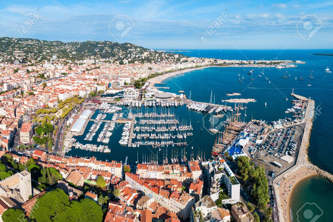 Cannes port aerial panoramic view. Cannes is a city located on the French Riviera or Cote d'Azur in France. - 122423603